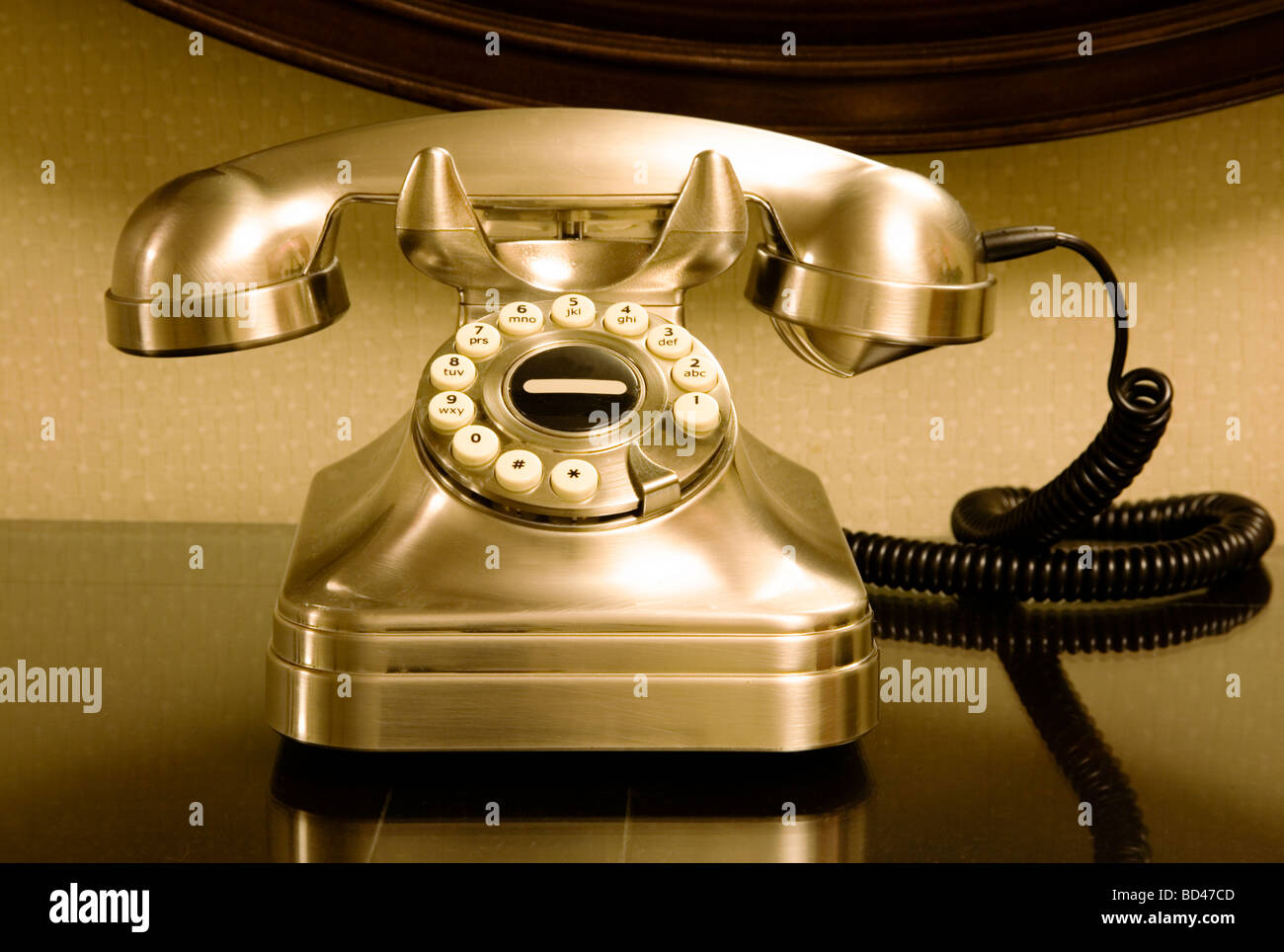 Traditional, vintage rotary style telephone on a desk - Stock Image