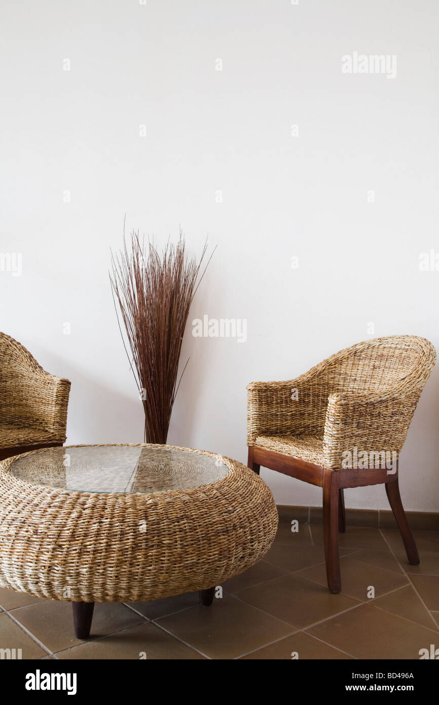 Wicker Table And Chairs Against A White Wall With Copy Space   Stock Image