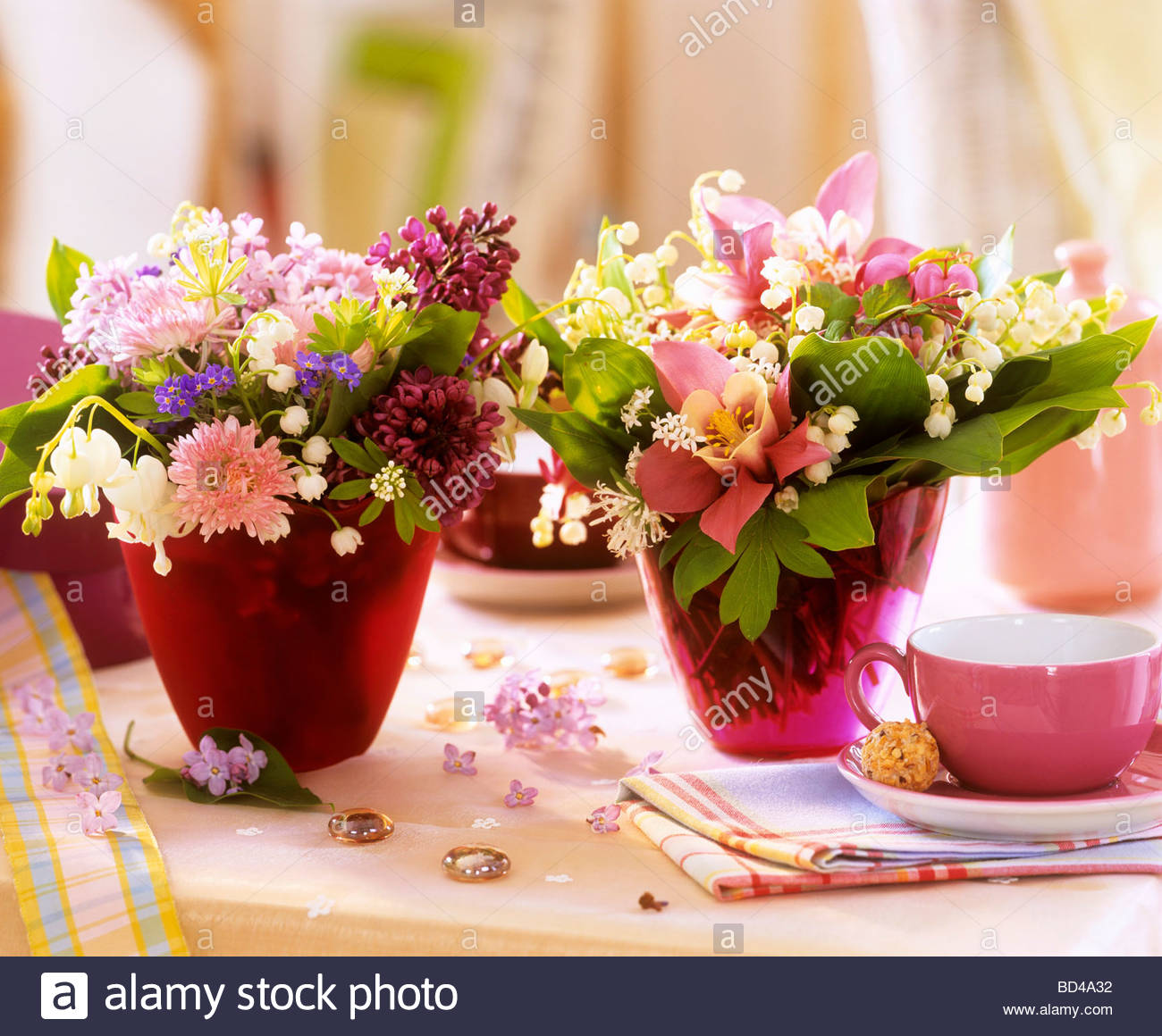 Small Posies Of Spring Flowers As Table Decoration Stock Photo