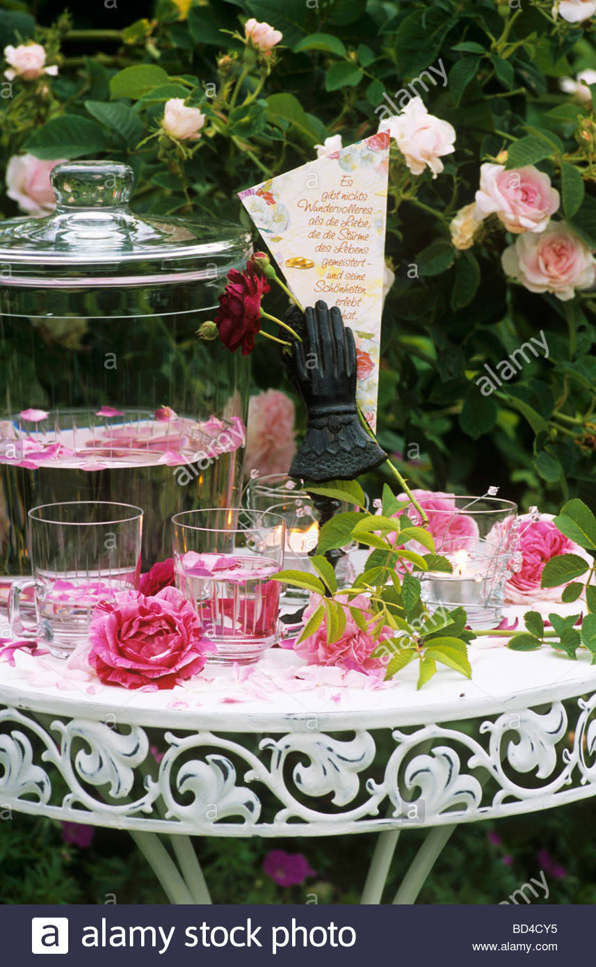 romantic table with roses rose punch and love poem stock photo