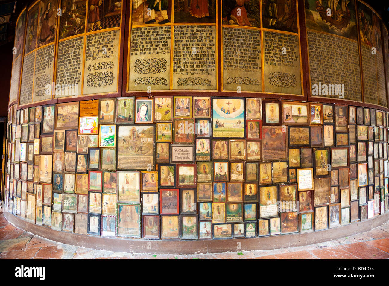 Votive art icons in the cloister on the shrine of the Chapel of the Miraculous Image in Altötting Bavaria Germany Stock Photo