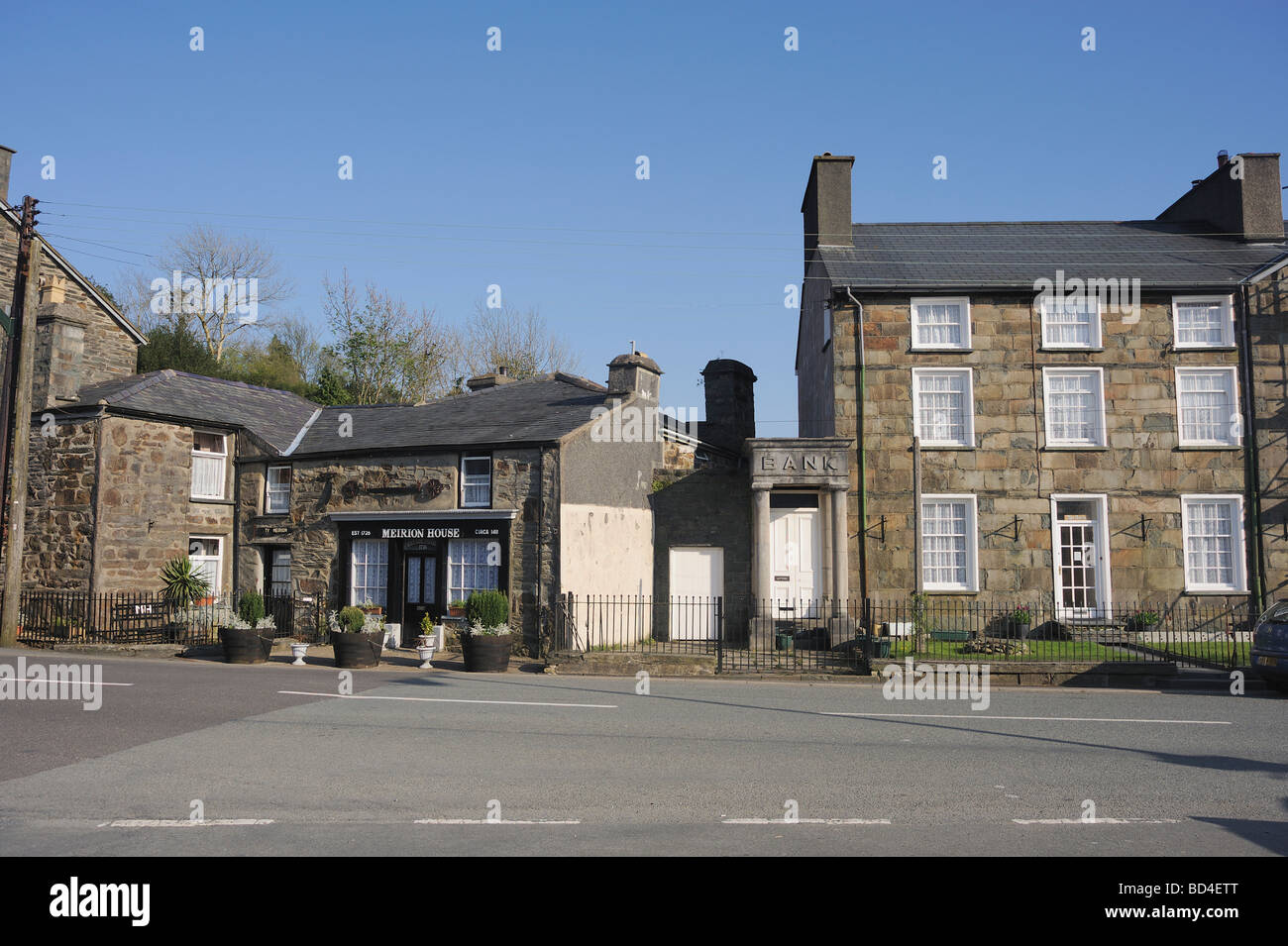 Former shop and bank buildings in Llan Ffestiniog, North Wales which have ceased trading and become private homes. - Stock Image
