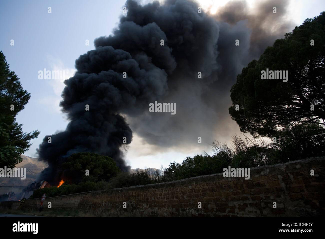 Plume of black smoke - Stock Image
