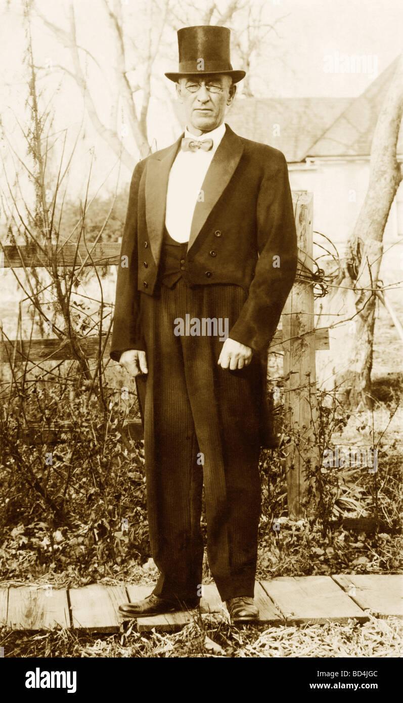 Older Man in Garden in a Tuxedo - Stock Image