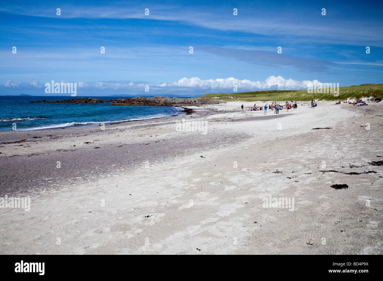 Teenagers playing organised beach games on a white sandy beach on the Island of Iona, in the Inner Hebrides, Argyll, - Stock Image