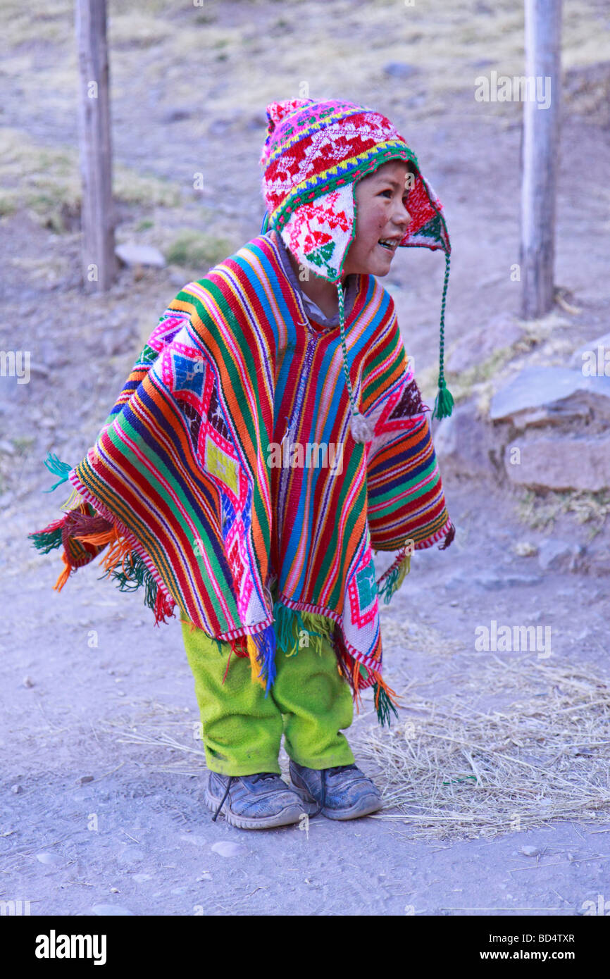 young boy dressed in a poncho, Pisac, Peru, South America - Stock Image