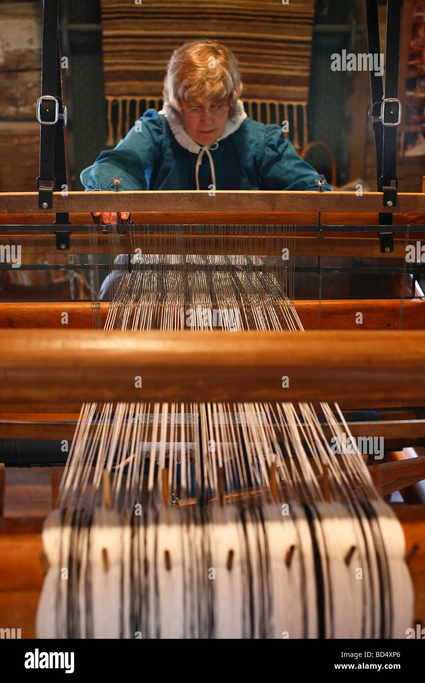 Historic craft hand loom textile warp Weaving shop Sauder Village Ohio USA historical re-enactment reenactment - Stock Image