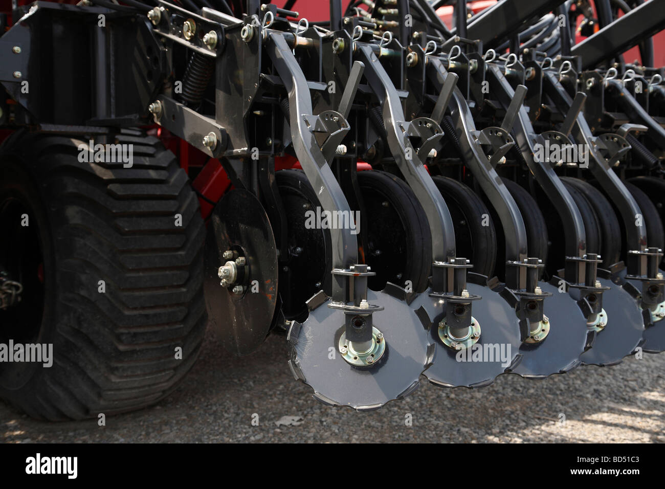 agricultural agriculture farming Heavy duty equipment Hiniker machine machines rotary disc closer seeder seeders - Stock Image