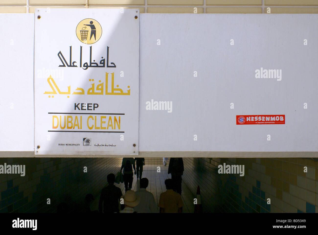 Signs at pedestrians underpass at the Dubai Creek, Deira, Dubai, United Arab Emirates - see description - Stock Image