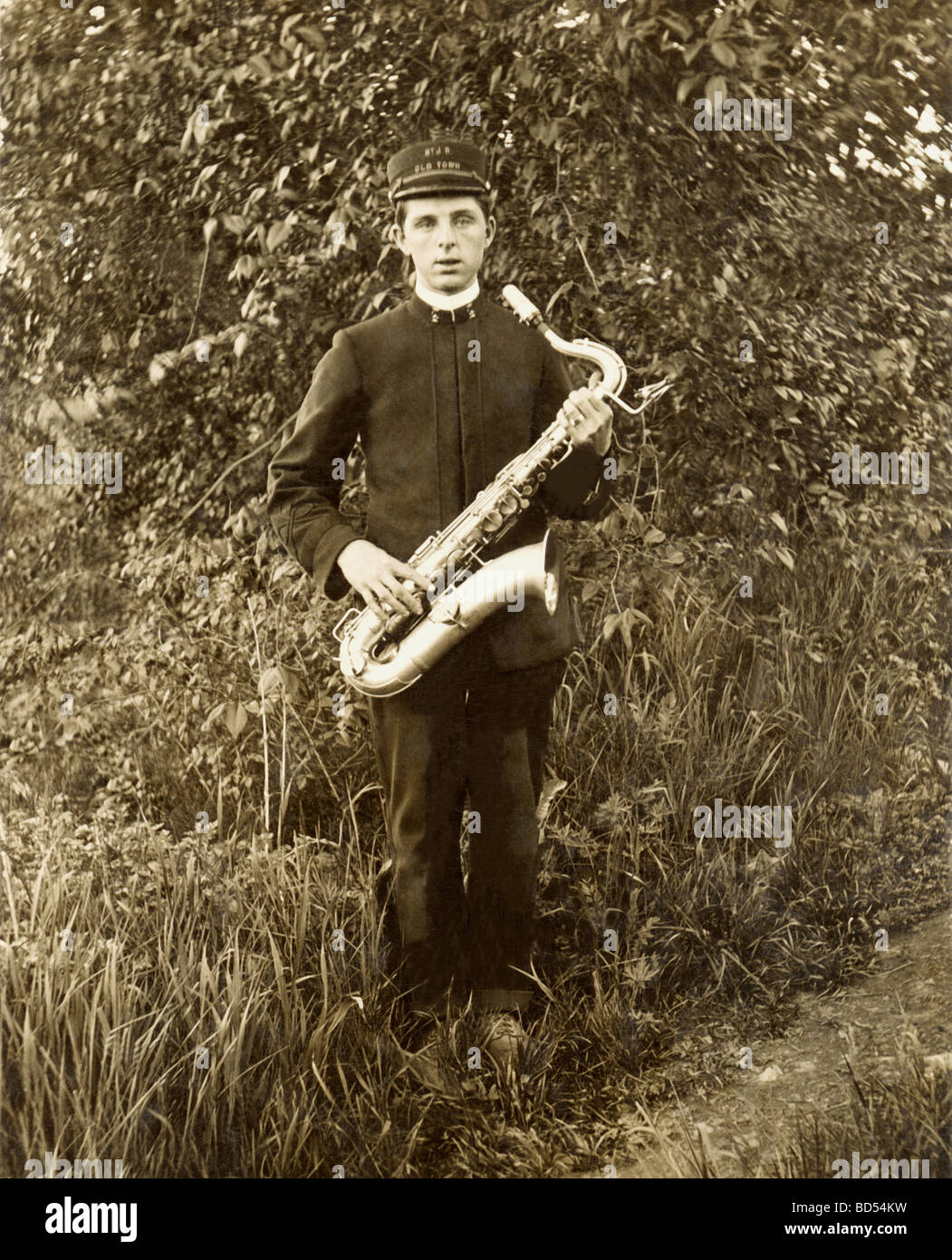 Old Town Band Member with Saxophone - Stock Image