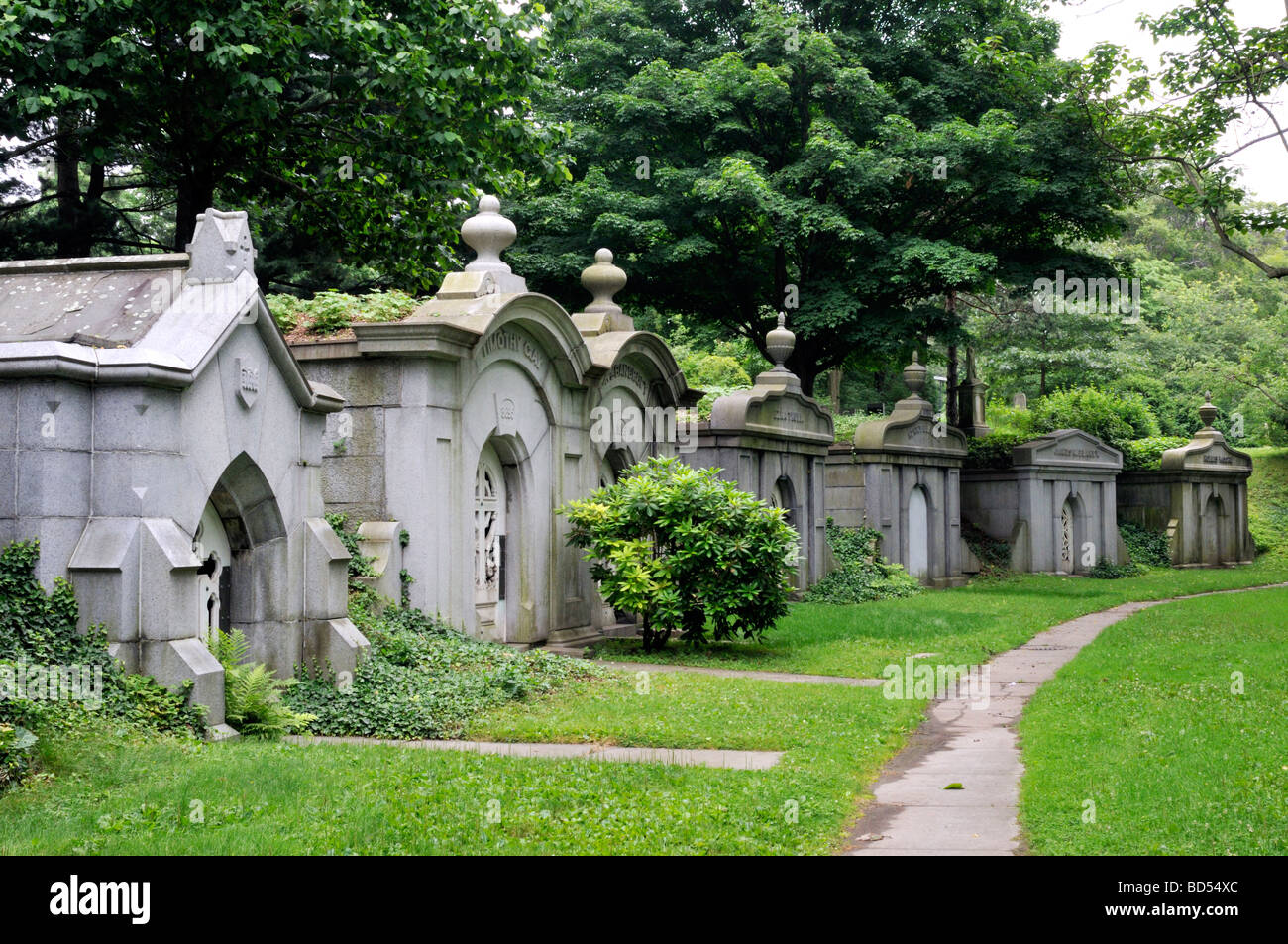 Row of old mausoleums in cemetery - Stock Image