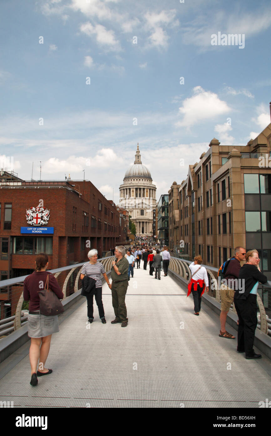 Londoners and vistors mix on the Millennium Bridge with St Pauls Cathedral behind. Stock Photo