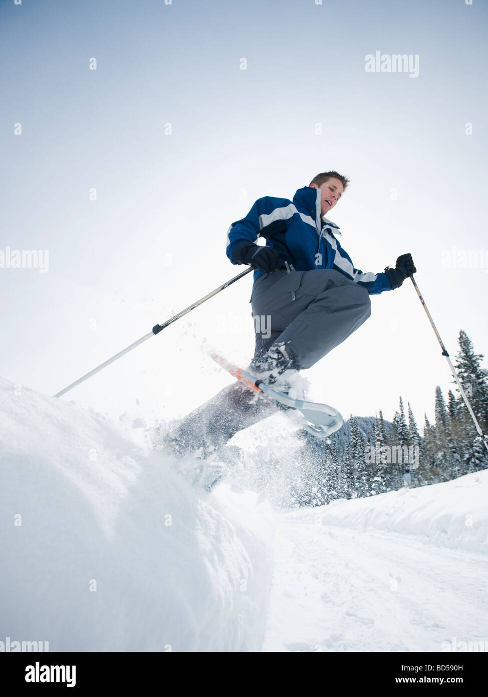 A man snow shoeing - Stock Image