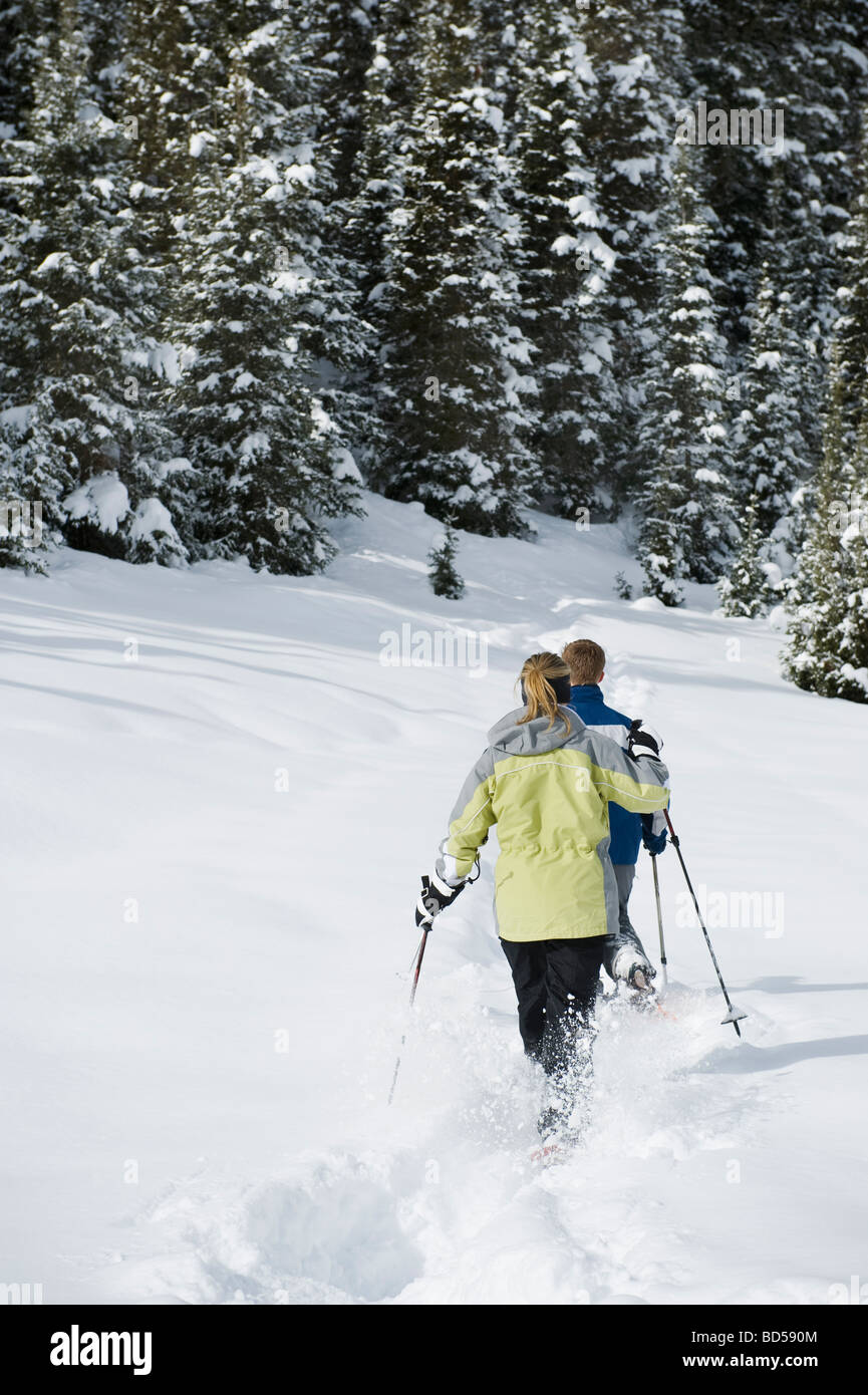 A couple snow shoeing - Stock Image