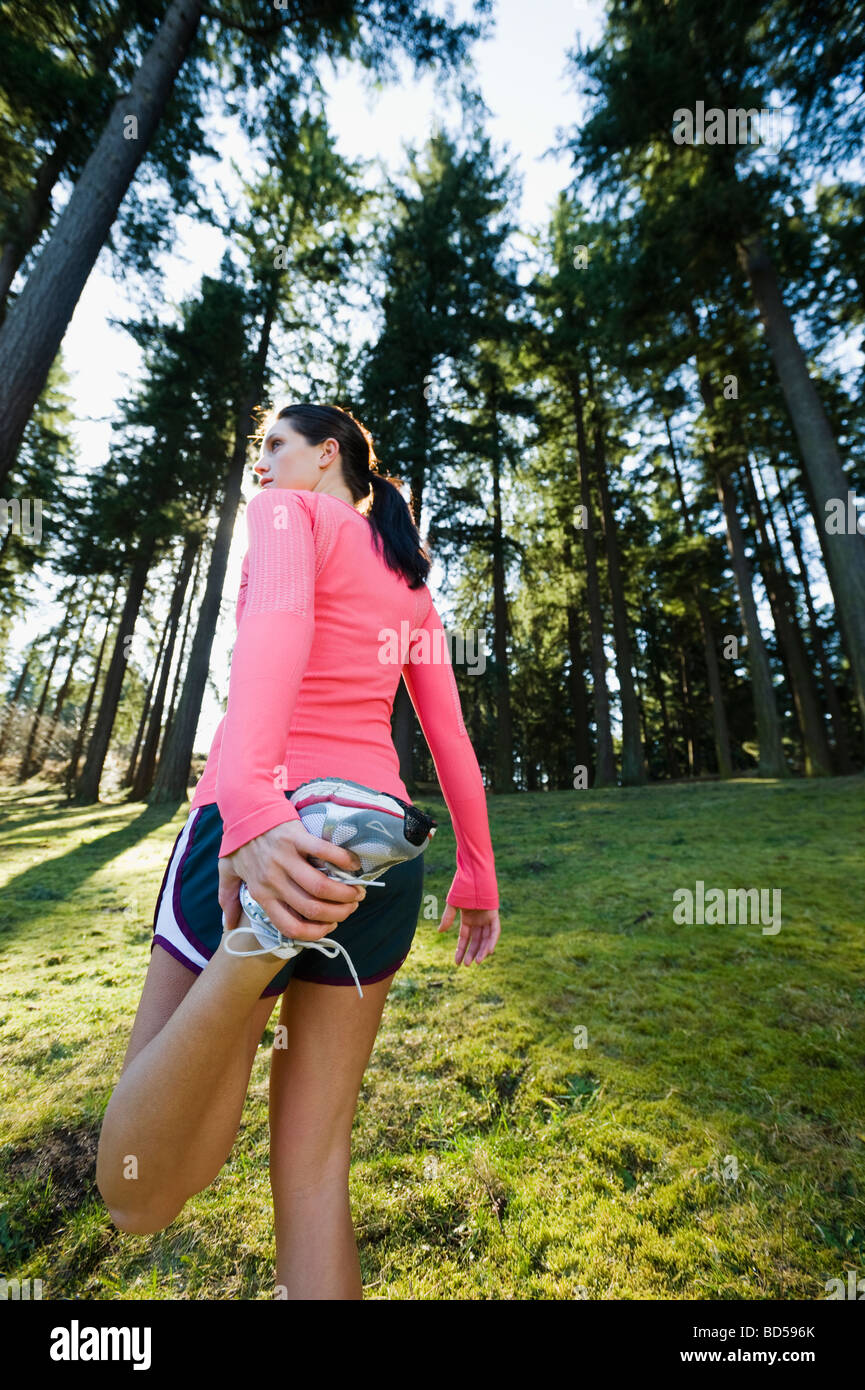 A runner in the woods - Stock Image
