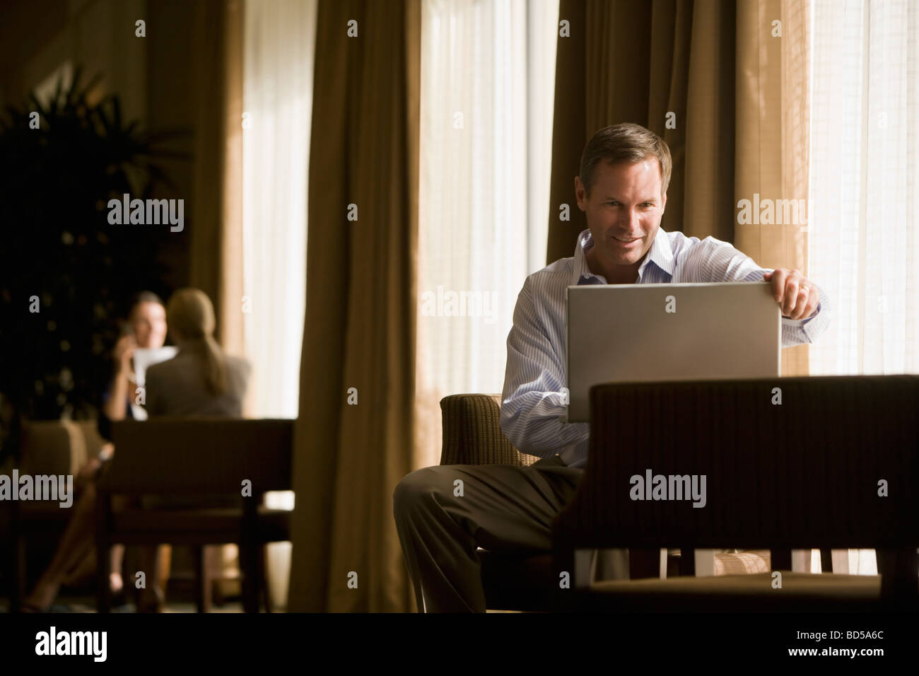 Business people in a lobby Stock Photo