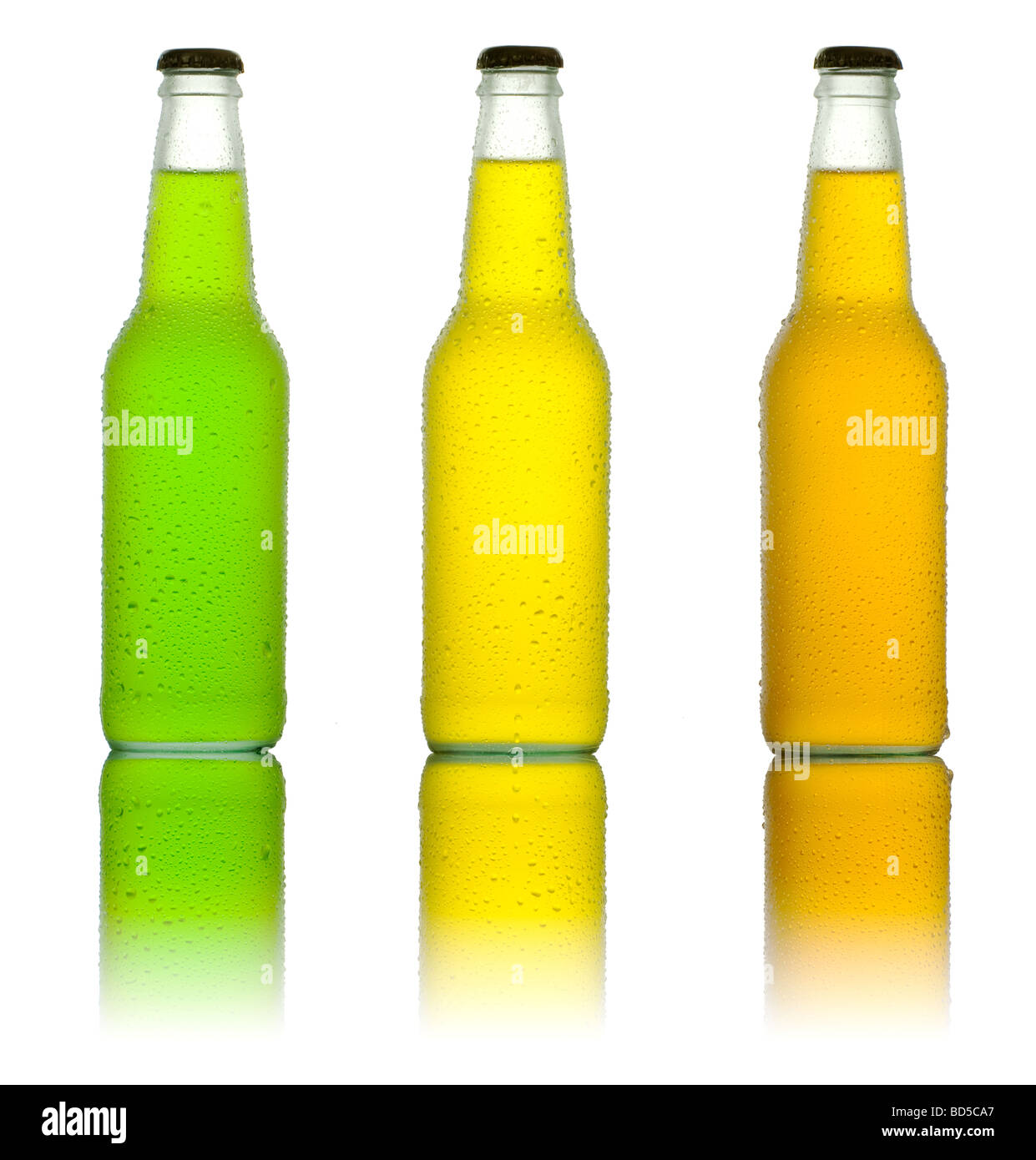 Three bottles with tropical drinks on white background - Stock Image