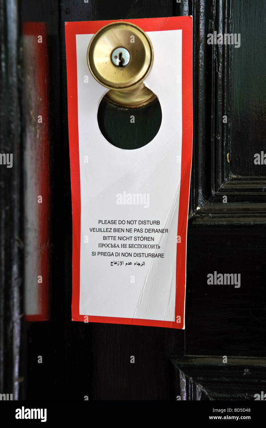 Tag Do not disturb on a hotel room doorknob - Stock Image