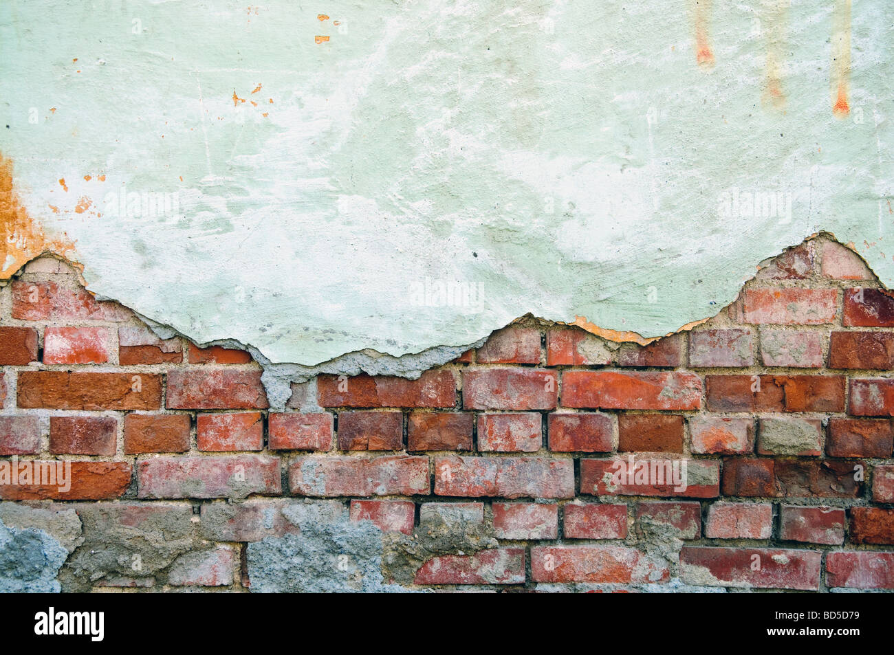 weathered obsolete old brick wall - Stock Image