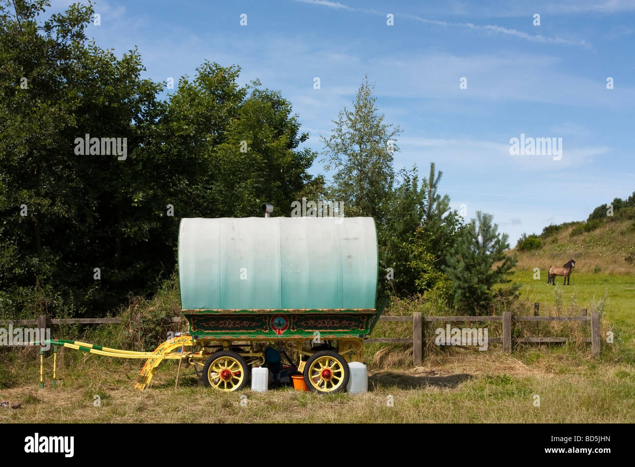 view of horse drawn Romany Gypsy caravan camp by the side of quiet b road in north east england - Stock Image