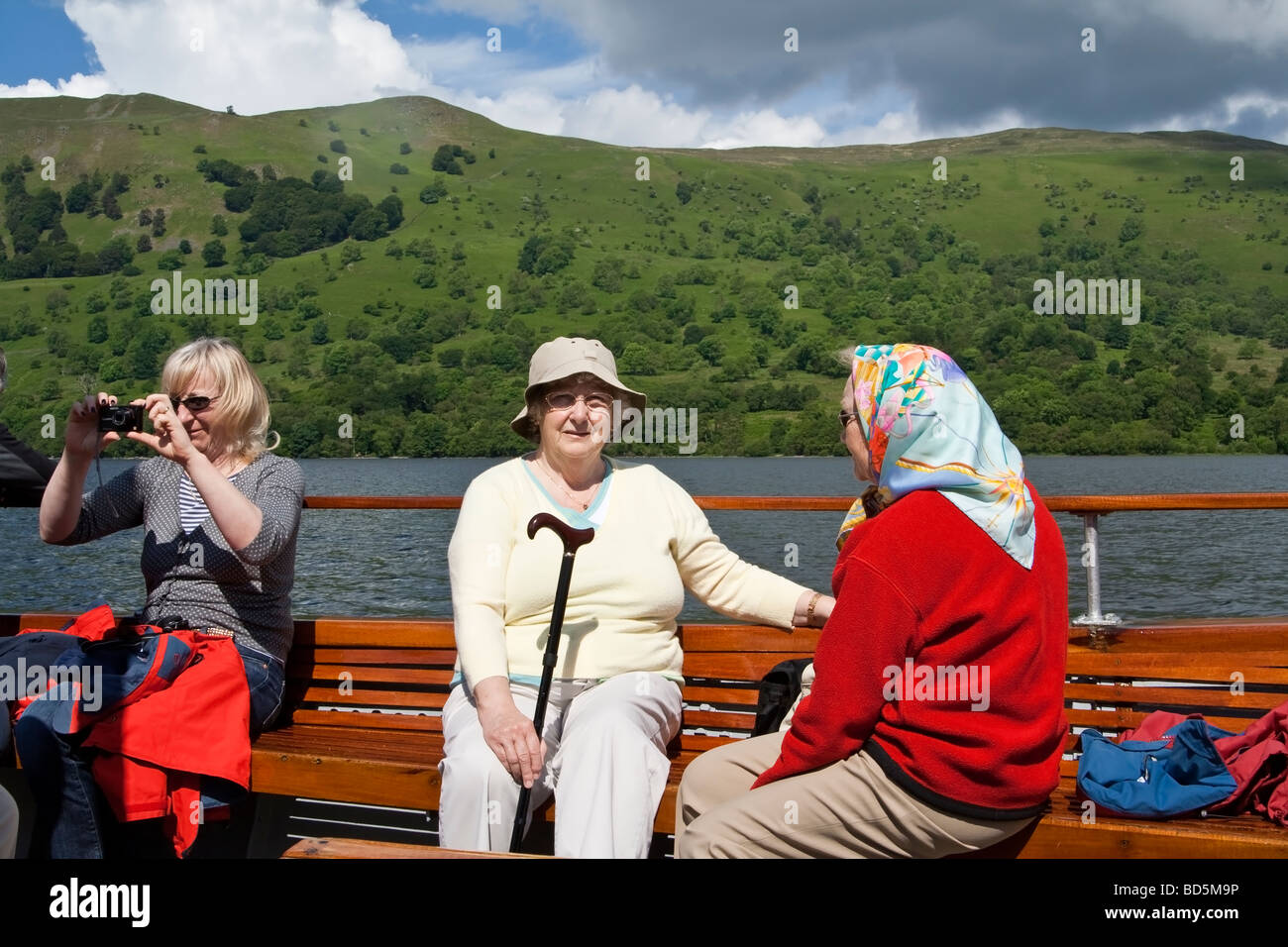 Passengers on a ferry on Ullswater, the Lake District, Cumbria, UK. Stock Photo