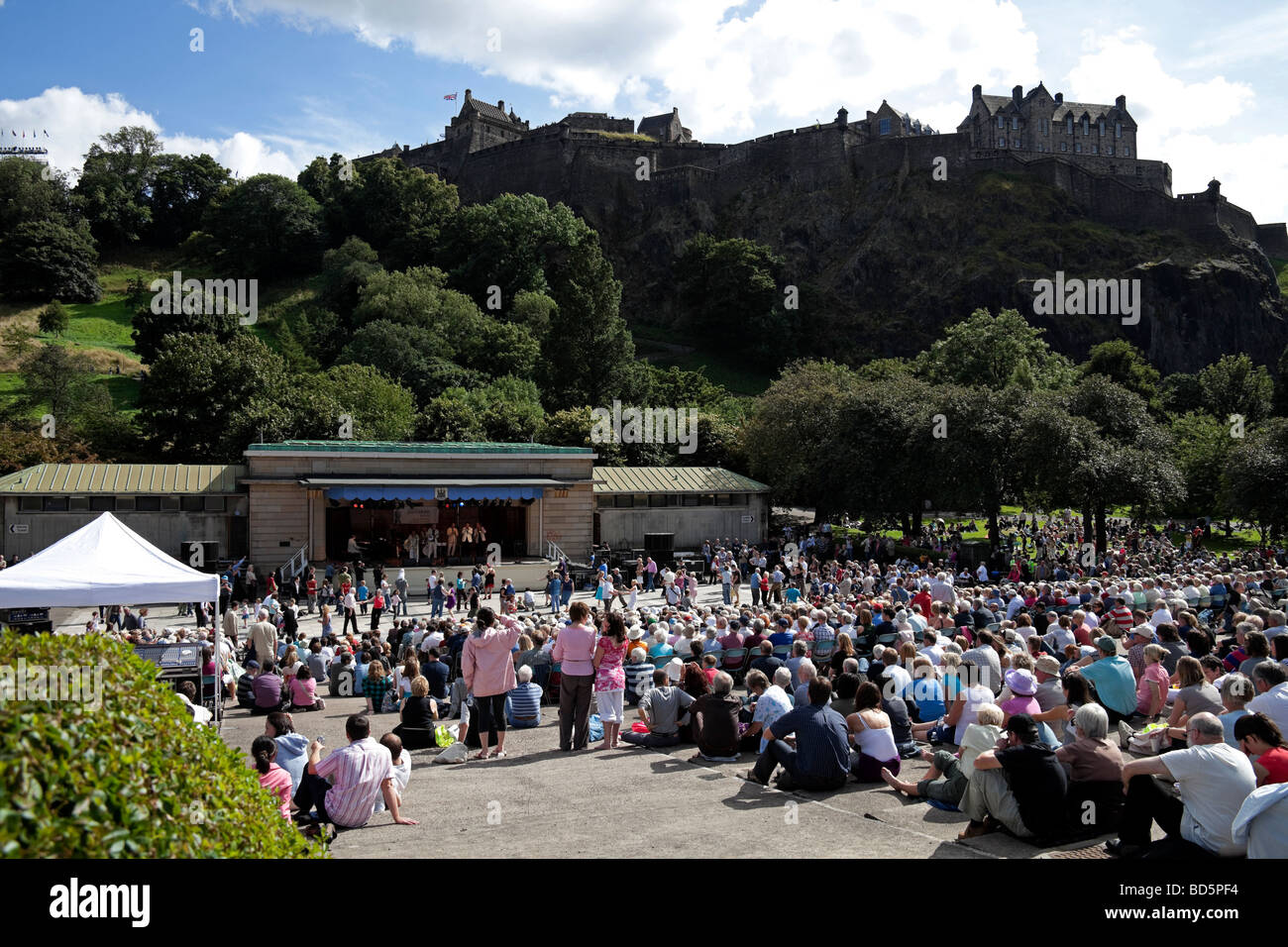 Edinburgh audience at Ross Bandstand with Castle in background during the annual Edinburgh Jazz Festival, Scotland, - Stock Image