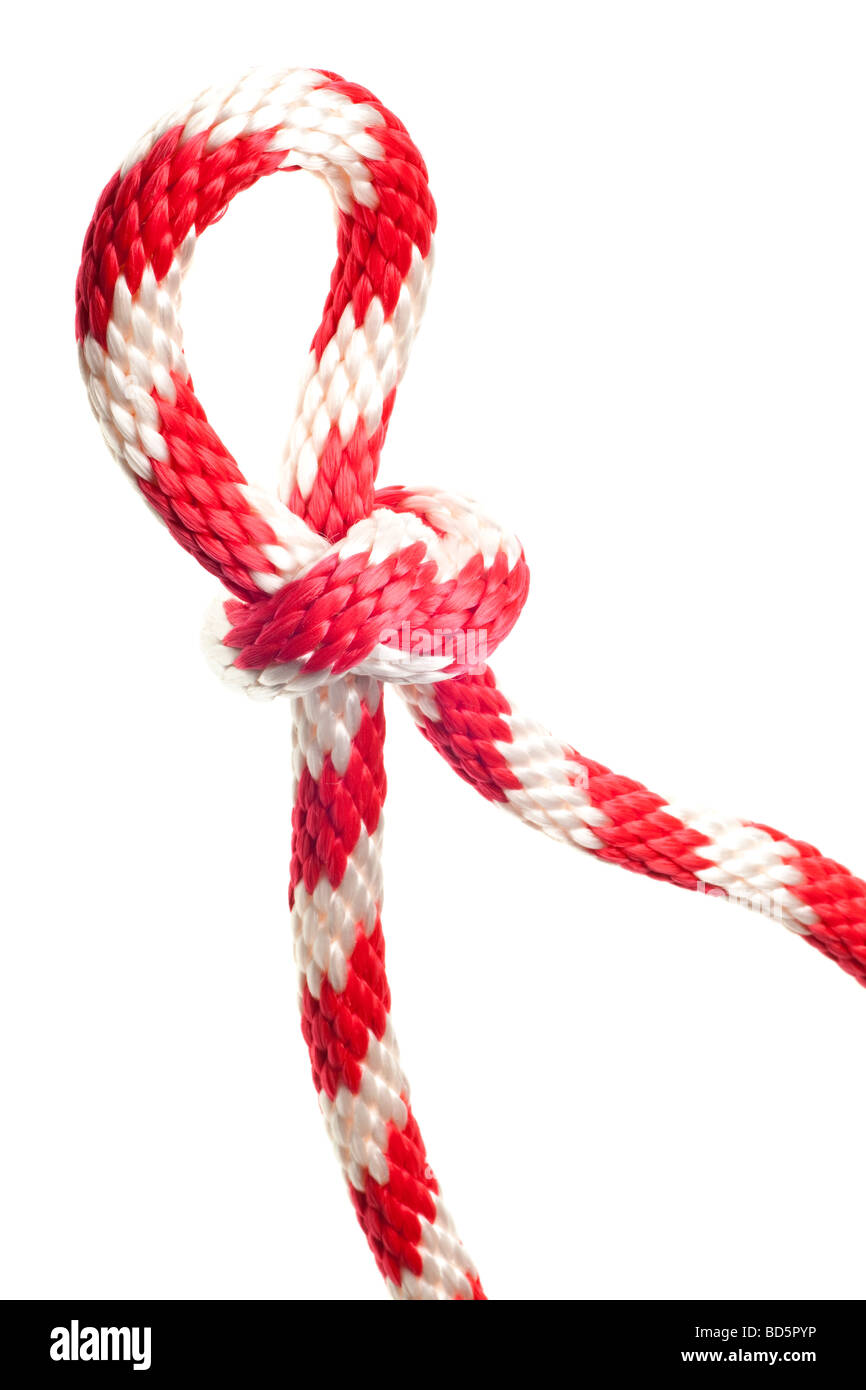 red and white nylon rope isolated on a pure white background - Stock Image