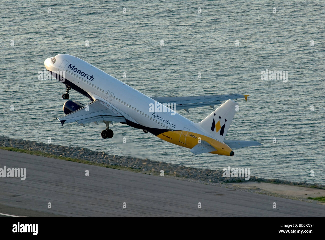 monarch airlines jet taking off from Gibraltar airport Stock Photo