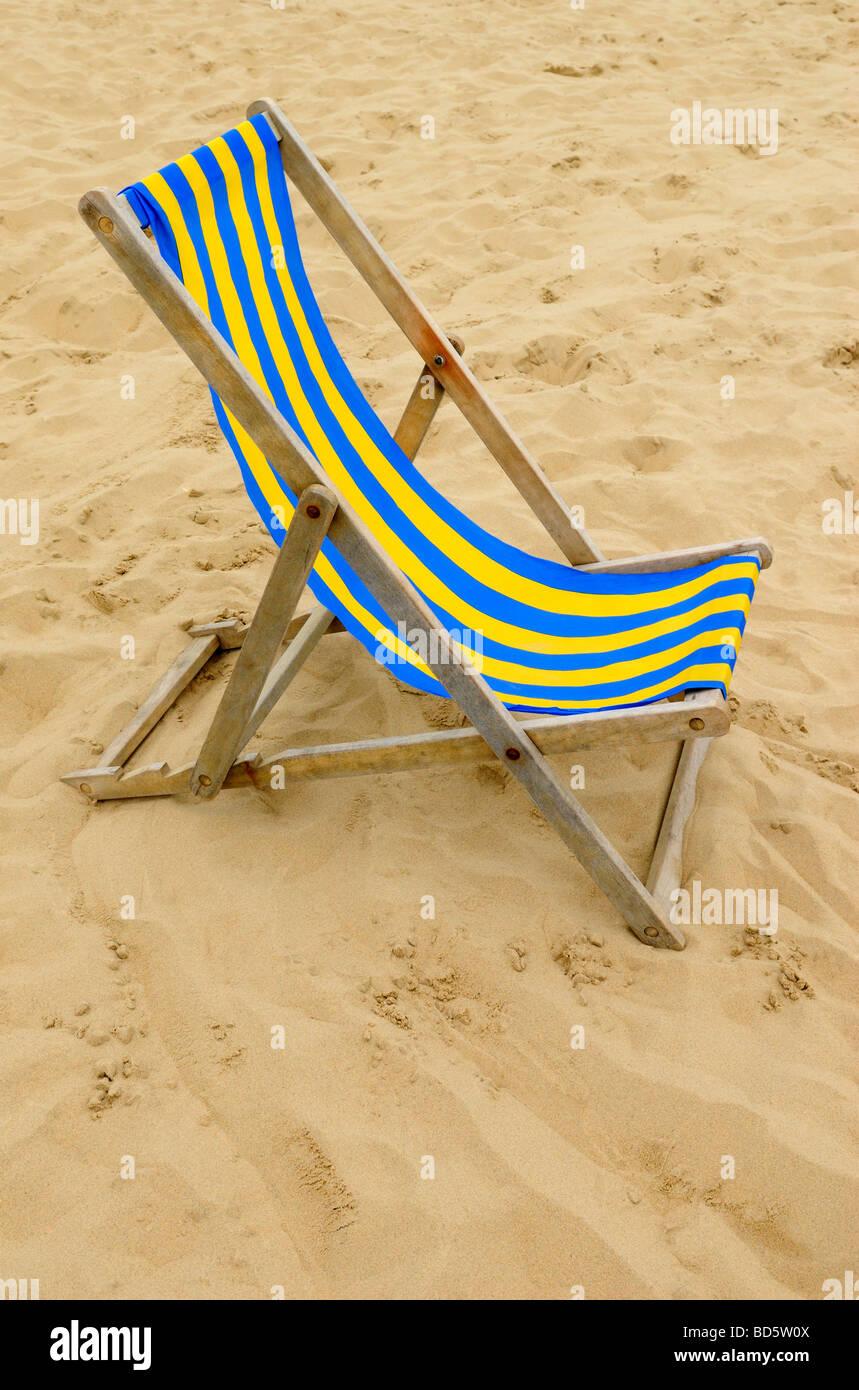 Empty Beach Deckchair - Stock Image