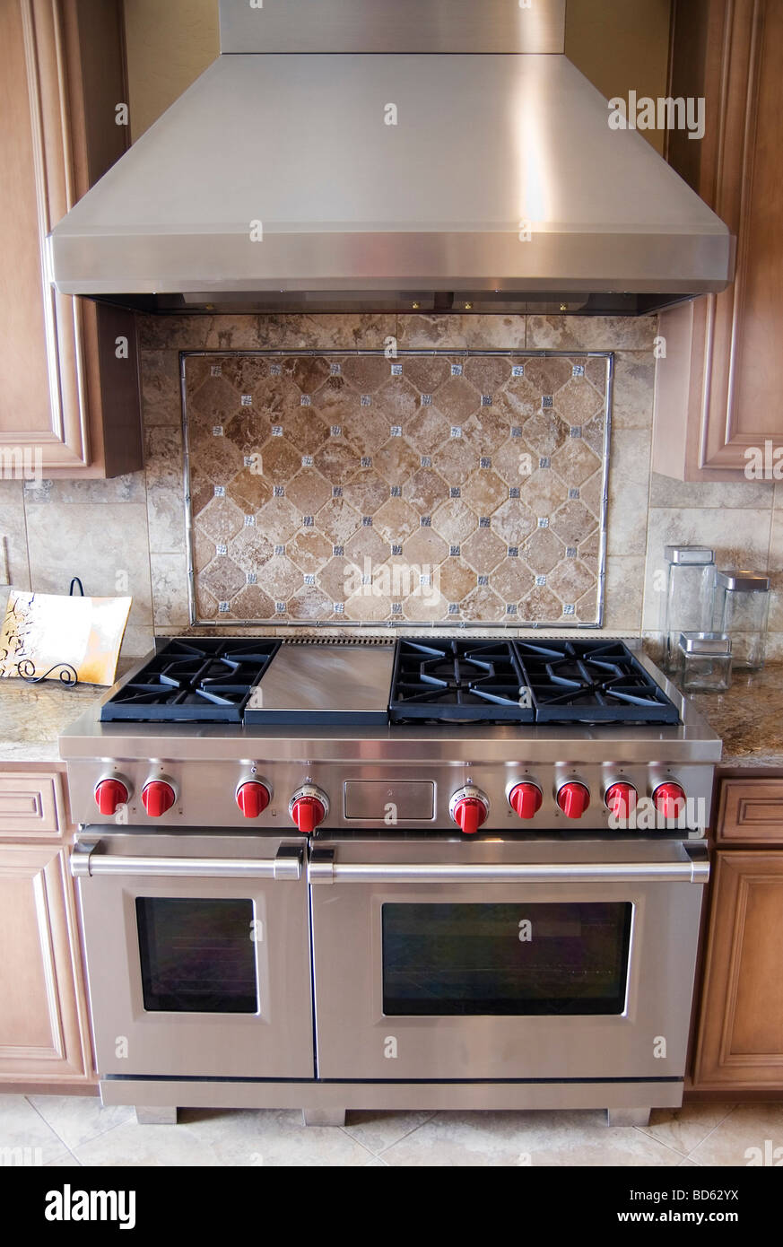 Modern kitchen with luxury state of the art gas oven stove cooker and hood Stock Photo