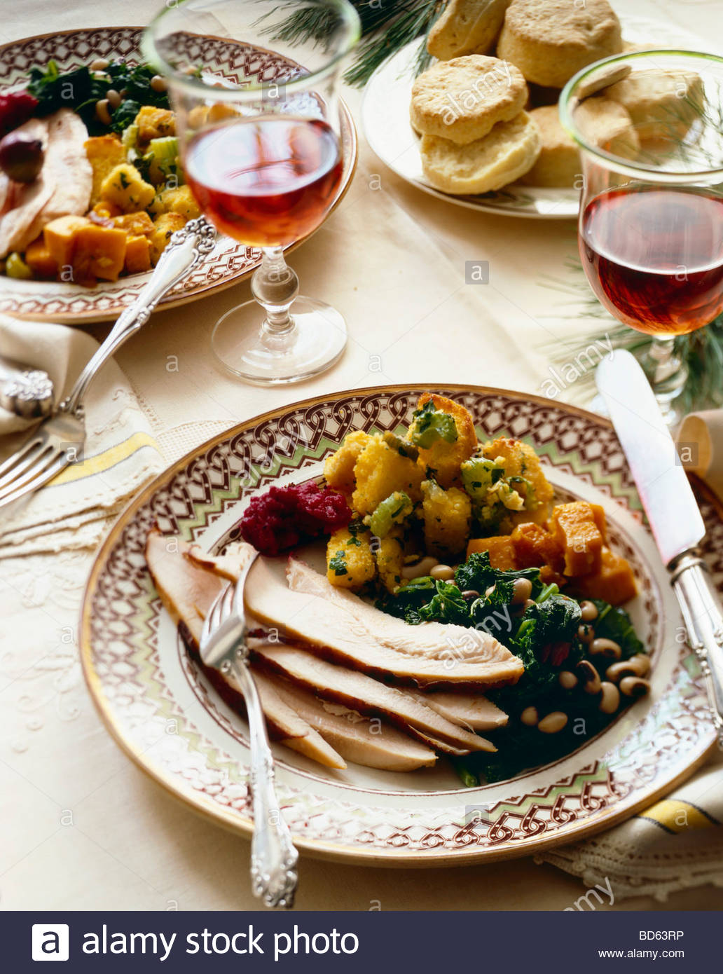Holiday Dinner Plate with Turkey and Sides on Dinner Table with Wine and Biscuits & Holiday Dinner Plate with Turkey and Sides on Dinner Table with Wine ...