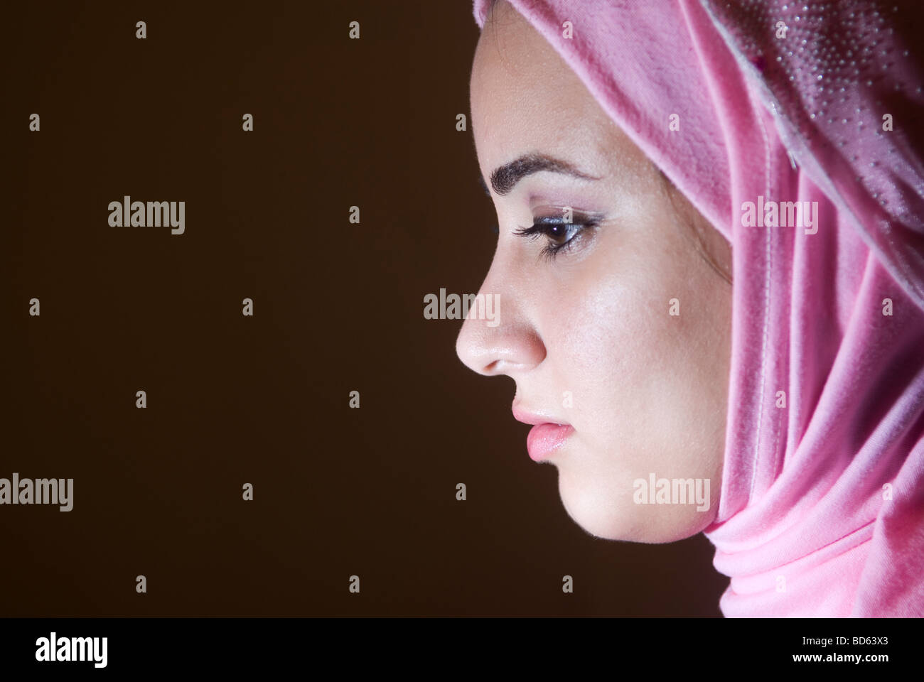 Young Muslim female contemplating - Stock Image
