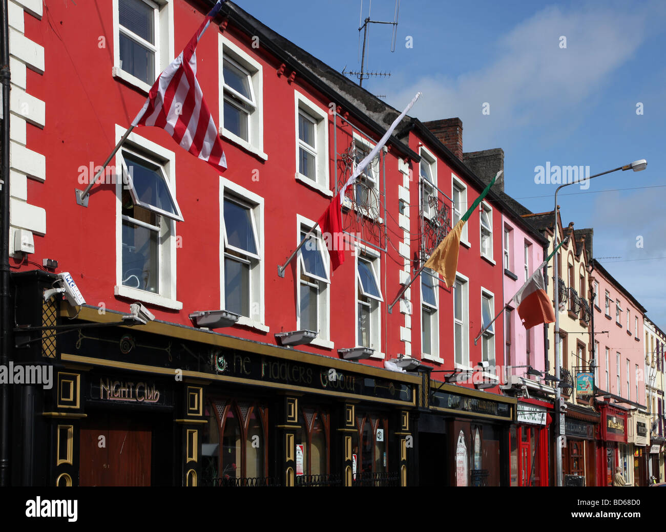 Carrickmacross Main Street coloured shop fronts - Stock Image