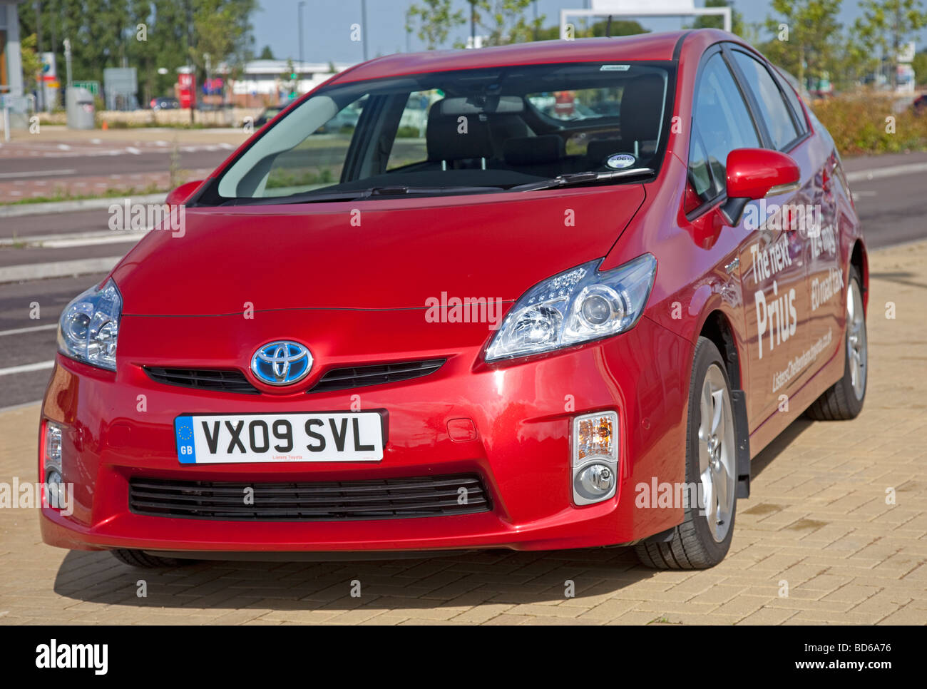 Front view red Toyota Prius T3 hybrid car parked Cheltenham UK - Stock Image