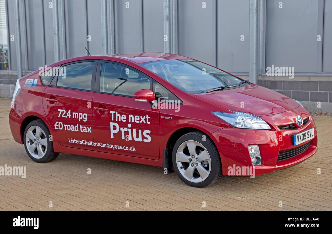 Red Toyota new Prius T3 hybrid car parked Cheltenham UK - Stock Image