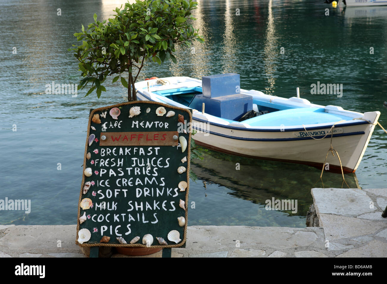 British Cafe Sign by the harbour of Kioni Greece - Stock Image
