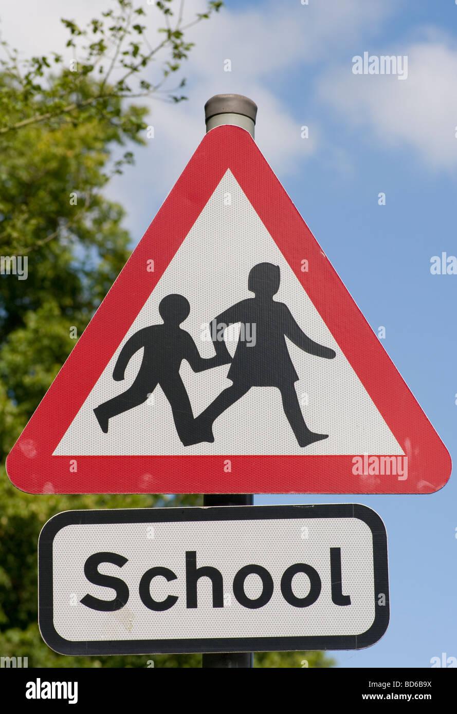 Triangular Warning School UK Road Traffic Sign Signs - Stock Image