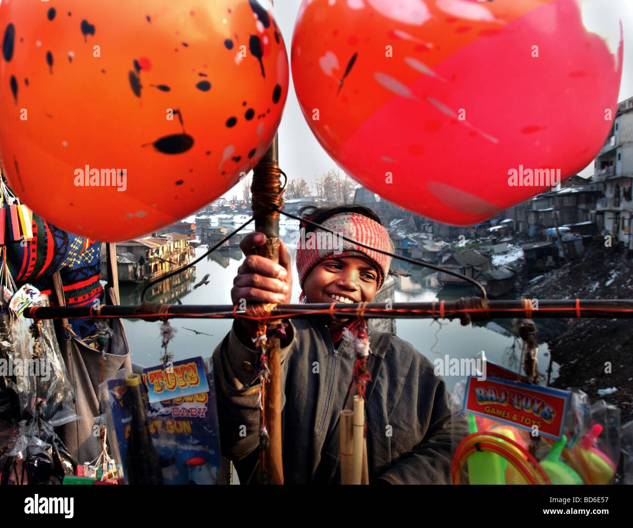A boy sells toys on a bridge in central Srinigar in the Indian held state of Kashmir Kashmir was once a tourist - Stock Image
