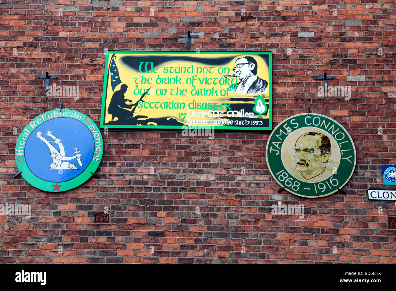 Three plaques on a wall in West Belfast, James Connolly, Liam McMillan,  and the Official Republican Movement - Stock Image