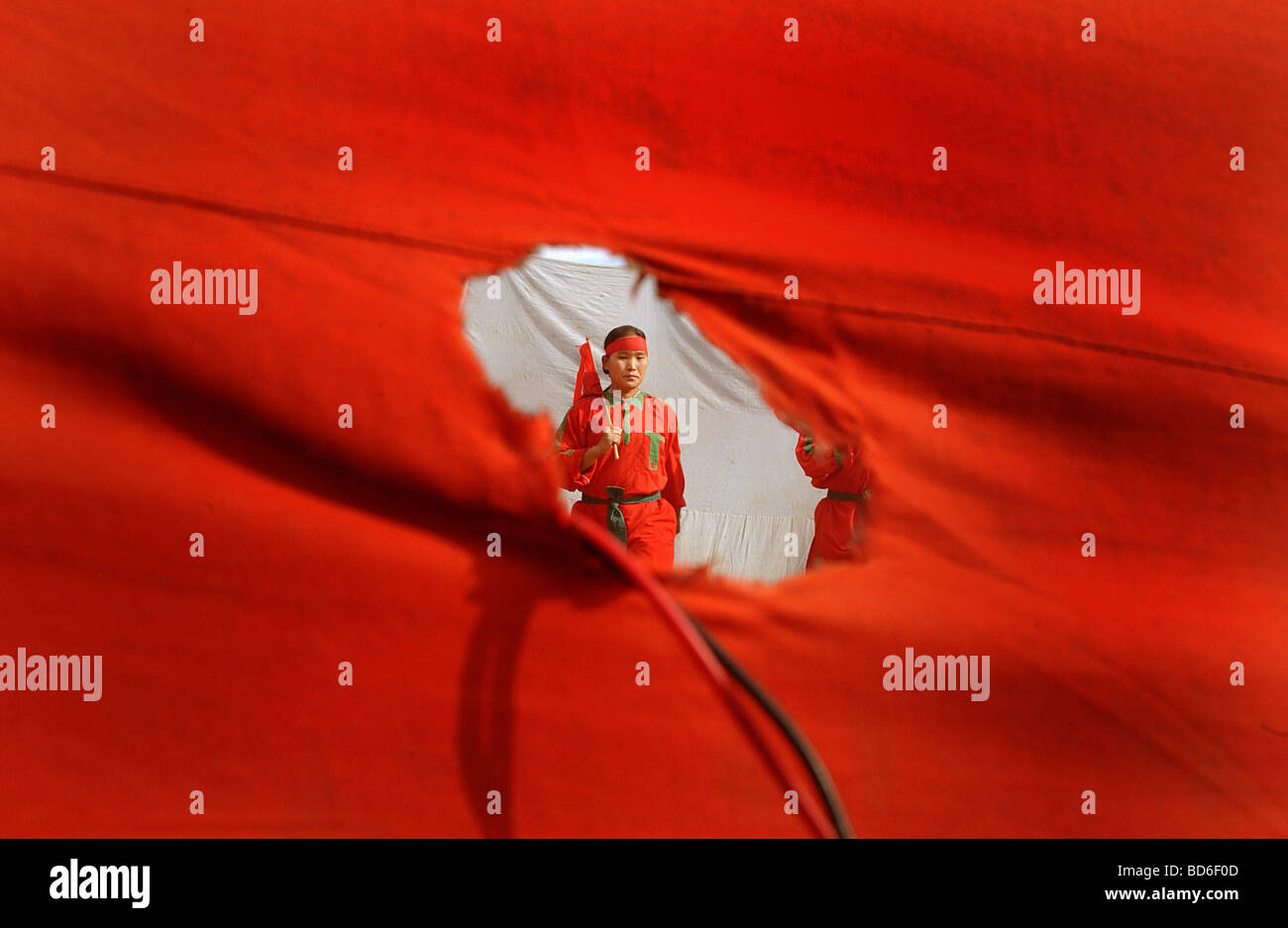 Maoists perform a traditional dance with Communist flags during a cultural program where over 1000 villagers came - Stock Image