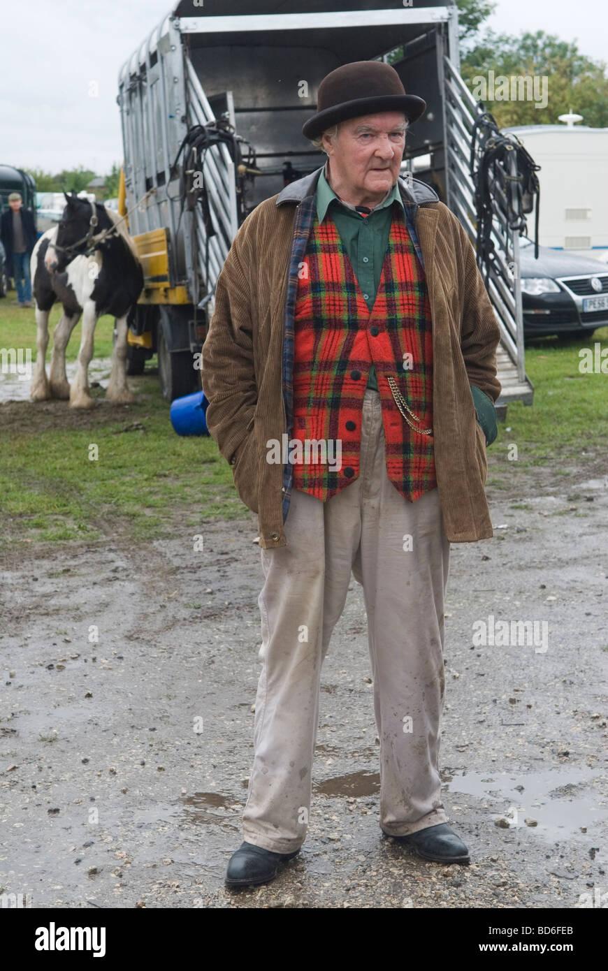 bfc8f4b468c85 Brigg Horse Fair Brigg Lincolnshire England Brown Derby bowler hat and  tartan waistcoat HOMER SYKES