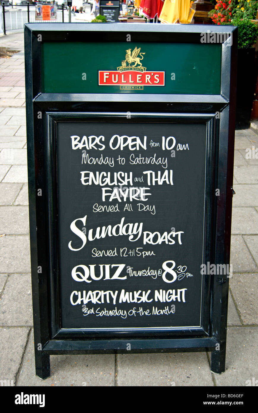 board outside a fuller's pub in chiswick, london, england, advertising food, a music night and pub quiz - Stock Image