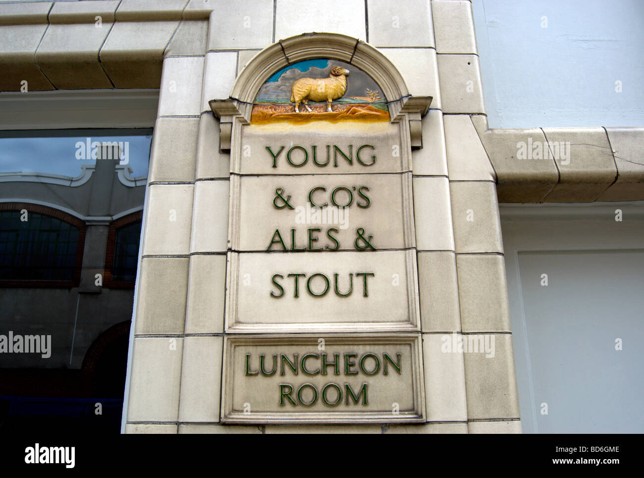 luncheon room and young & co's ales and stouts signs, and image of a ram, at the crown and anchor pub, chiswick, - Stock Image