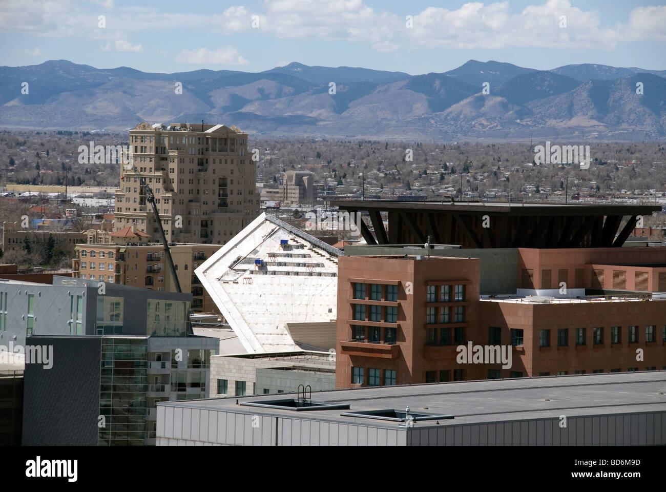 A view from the Colorado State building Denver, showing the Denver Art Museum building and the Rocky Mountains in - Stock Image