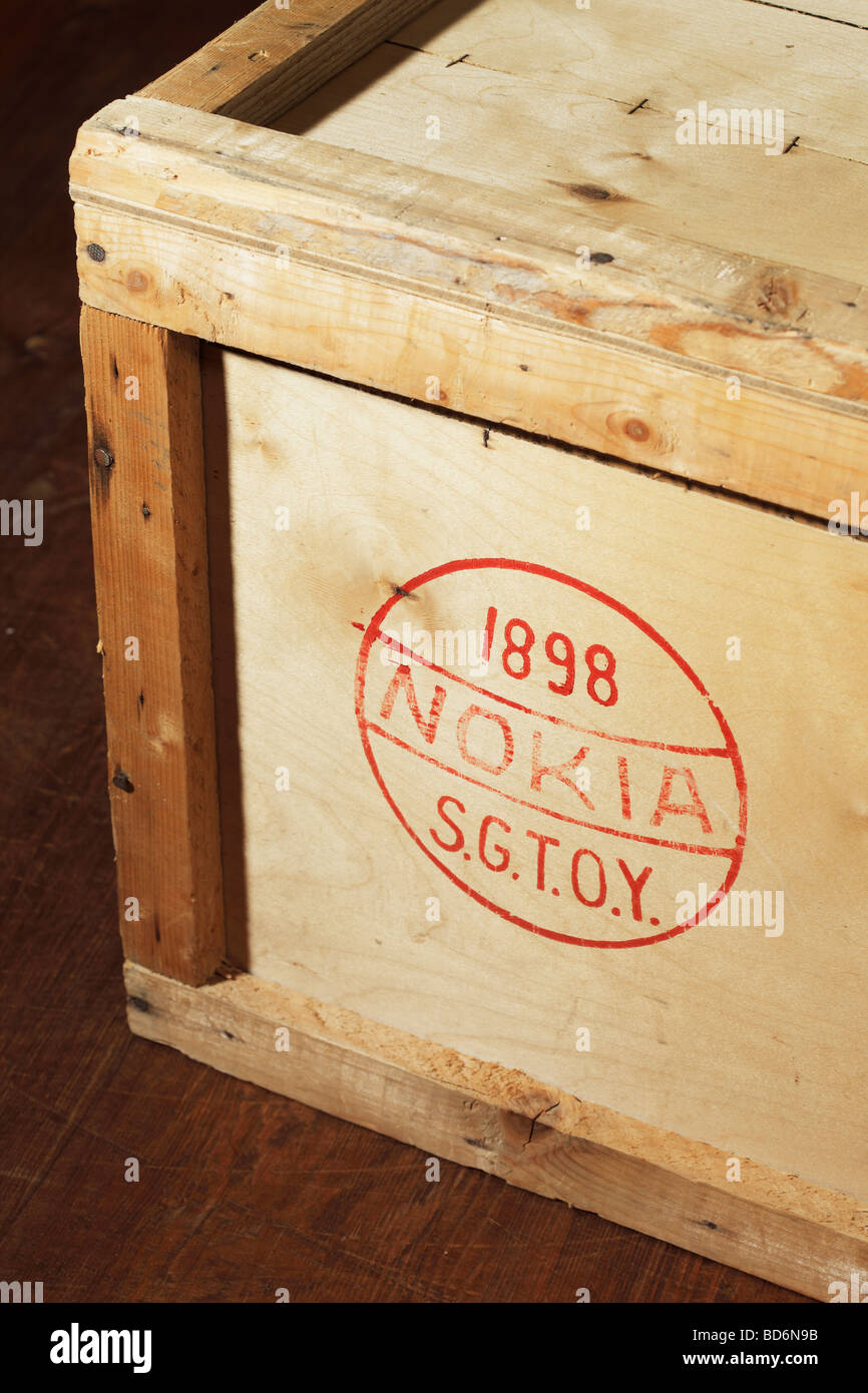 Wooden crate with old Nokia logo - Stock Image