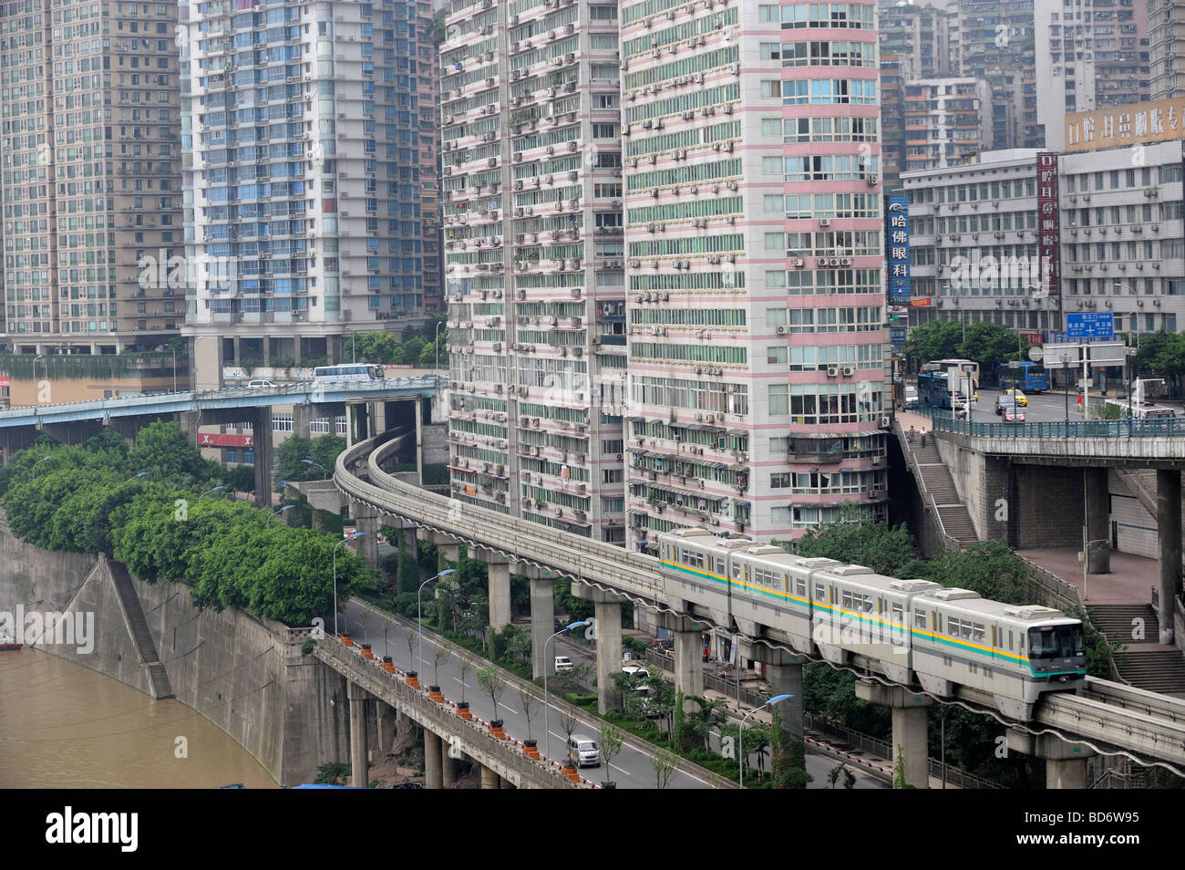 Chongqing metro train across high density apartments. 02-Aug-2009 - Stock Image
