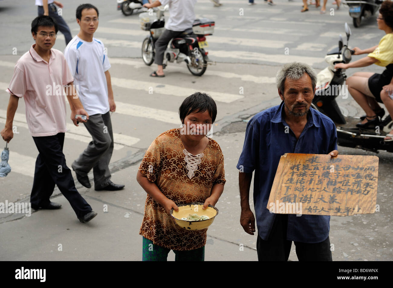 Chinese couple begging in Zhumadian, Henan, China. 05-Aug-2009 - Stock Image