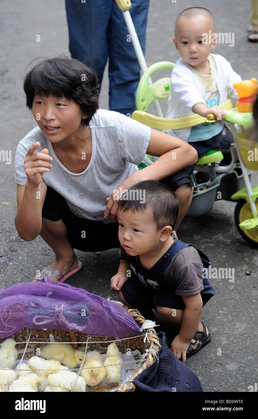 Chinese children playing in Zhengzhou, Hennan, China. 06-Aug-2009 - Stock Image