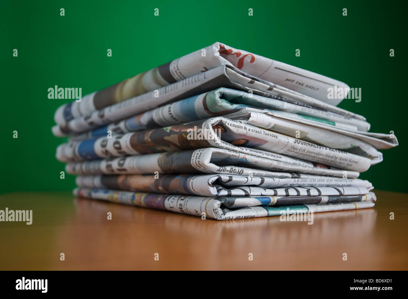Stack of reading and research newspaper an old fashioned way of consuming news of the day - Stock Image