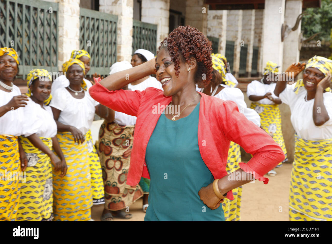 Woman dancing with a women's church group, homestead of the chieftain, Fon, Bafut, West Cameroon, Cameroon, - Stock Image